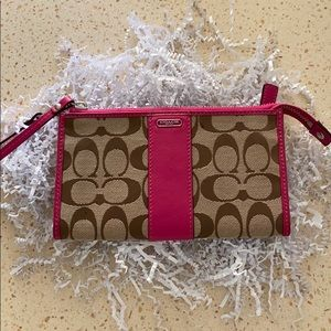 Coach wristlet, traditional print with pink accent
